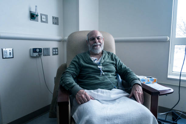 Outpatient Senior Adult Man Cancer Patient During Chemotherapy IV Infusion stock photo