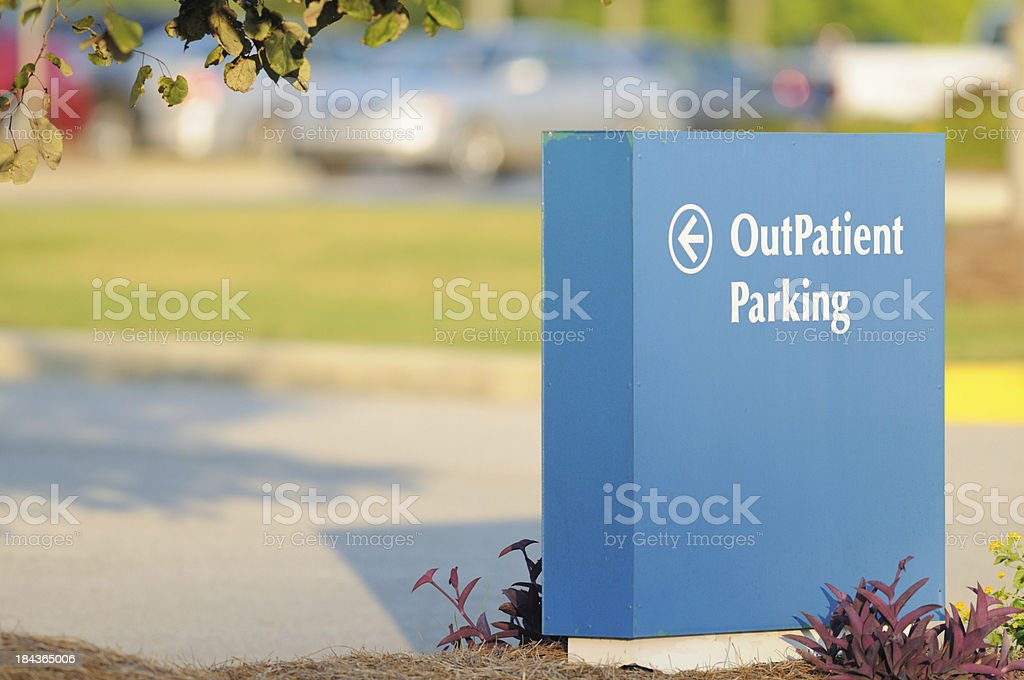 Outpatient sign for parking stock photo
