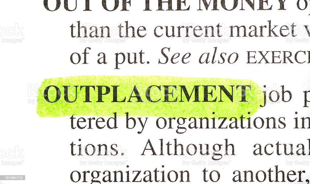 Outplacement definition highlighted in dictionary stock photo