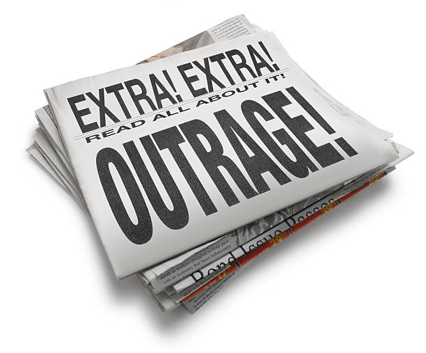 Outrage! A newspaper with headline