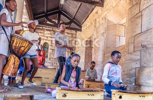 Outreach Foundation marimba band, children learning to play the instrument with the Lutheran church in the background in Hillbrow, Johannesburg. Hillbrow is a densely populated residential area in Johannesburg. Johannesburg, also known as Jozi, Jo'burg or eGoli,