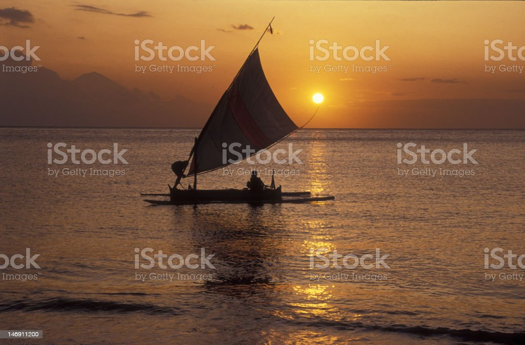 Outrigger at sunset stock photo