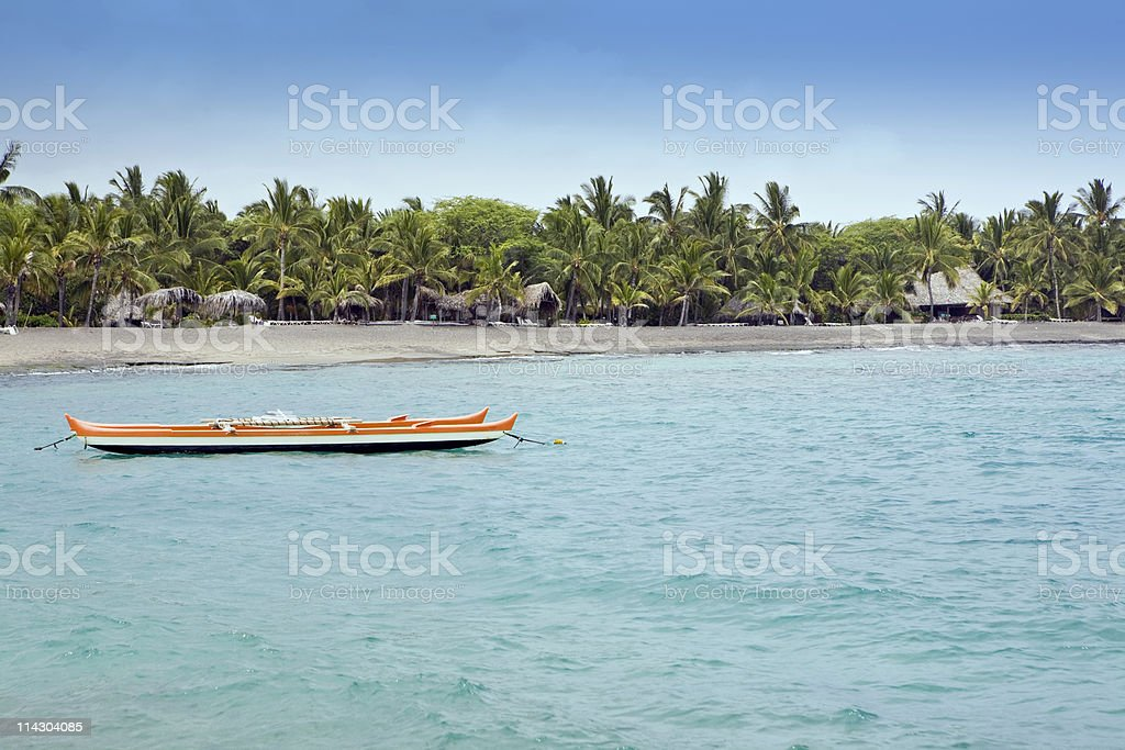 Outrigger Canoe In The Cove stock photo