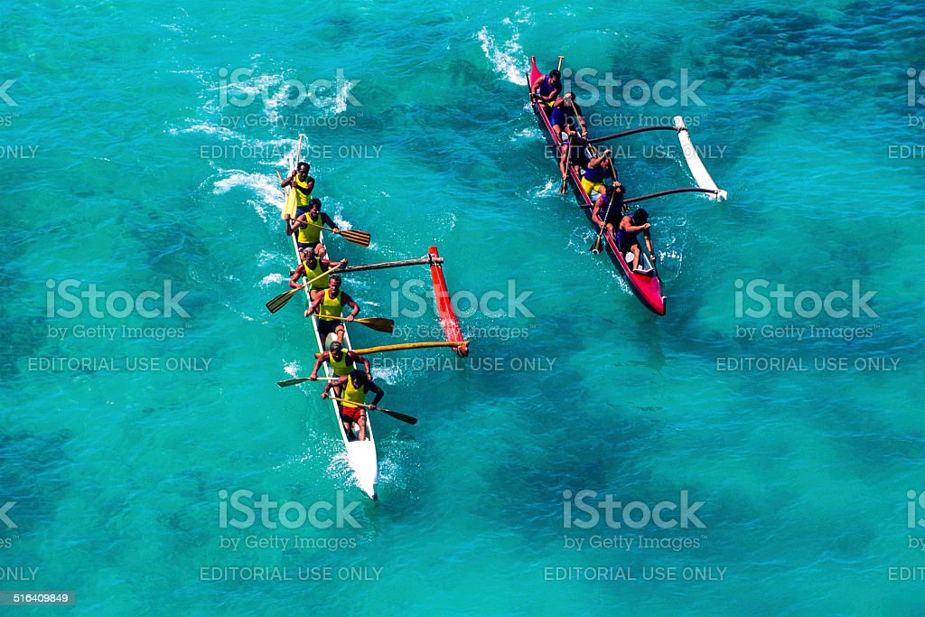 Outrigger canoe racing at Waikiki Beach stock photo