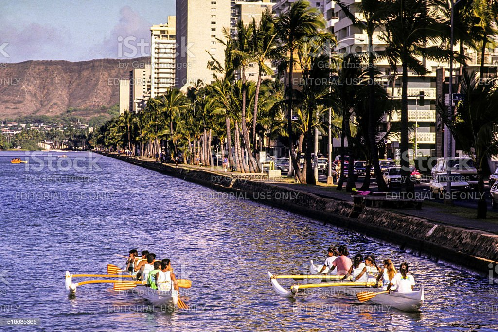 Outrigger canoes on the Ala Wai Canal stock photo