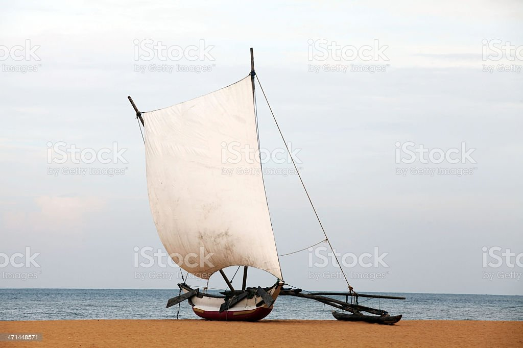 Outrigger Prahu or Proa on the Beach in Sri Lanka royalty-free stock photo