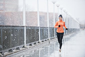 Full length shot of a young woman running in the rainhttp://195.154.178.81/DATA/i_collage/pu/shoots/804997.jpg