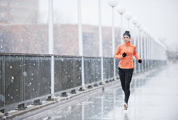 Outrun bad weather Full length shot of a young woman running in the rainhttp://195.154.178.81/DATA/i_collage/pu/shoots/804997.jpg individual event stock pictures, royalty-free photos & images
