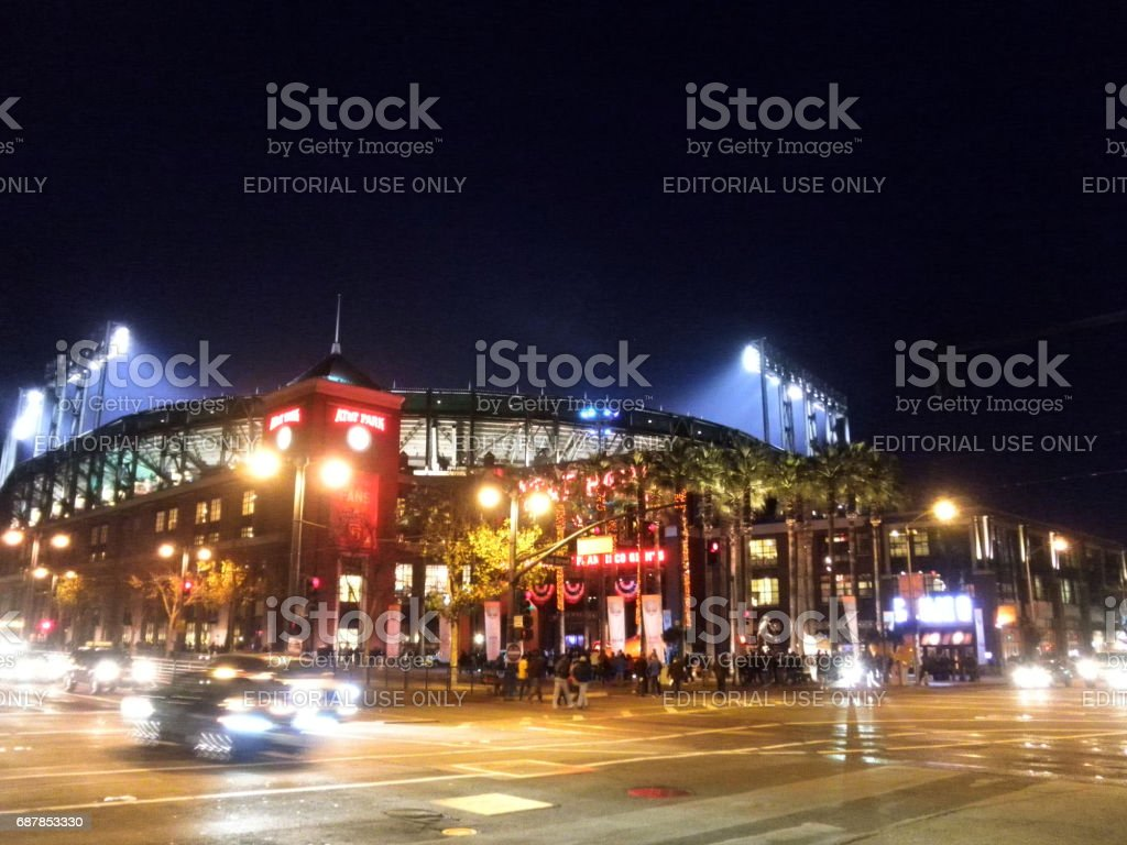 Outside AT&T Park at night as light shine into stadium during sporting event stock photo