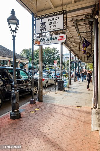 New Orleans, USA - Dec 17, 2017: Outside Cafe Du Monde and Grandad's General Store. Along the pavement on the popular and iconic Decatur Street in the French Quarter.