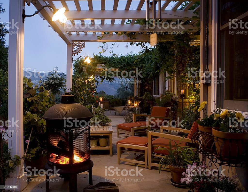 Outside deck with plants and fire pits stock photo