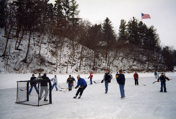 outside ice hockey game on frozen pond - isvak bildbanksfoton och bilder