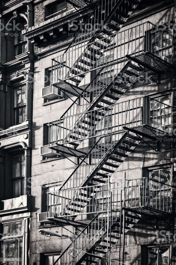 Outside metal fire escape stairs, New York City, black and white