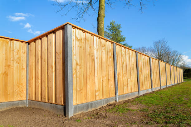 Outside new wooden fence around garden stock photo