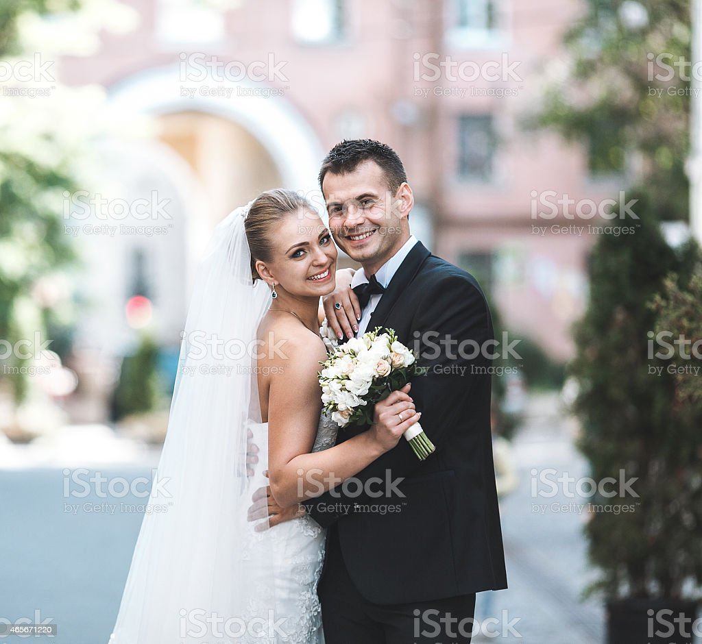 Outside photograph of a happy bride and groom stock photo
