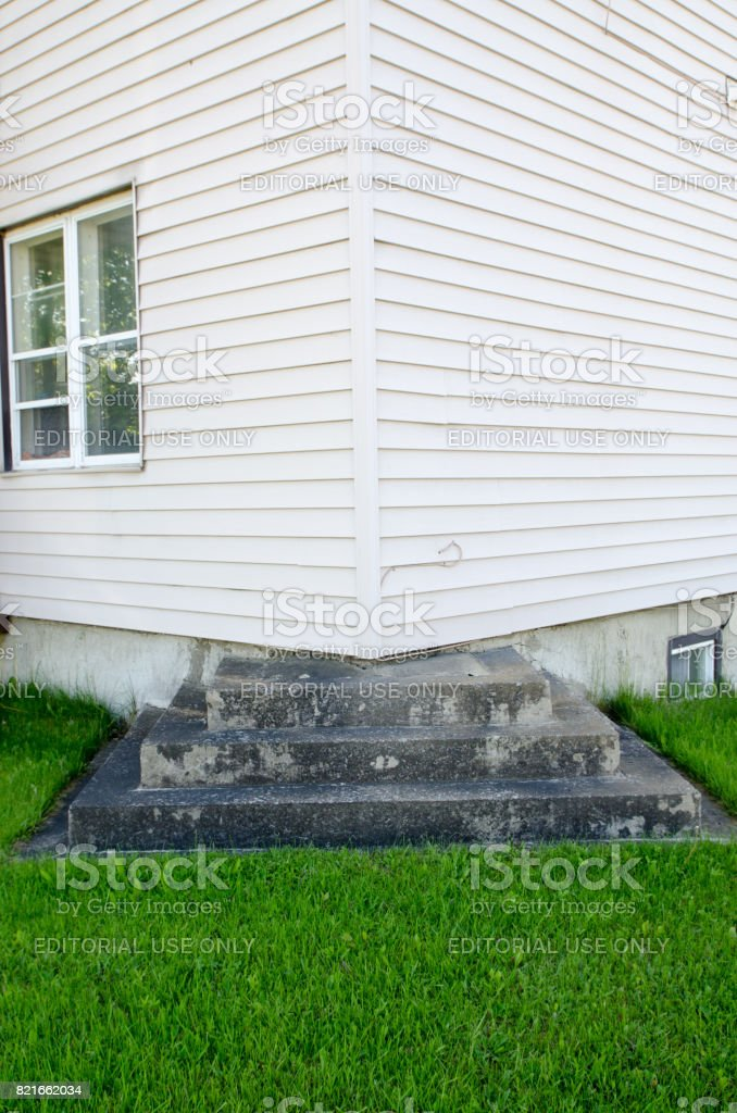 Outside residential step leading to corner of house with no door stock photo