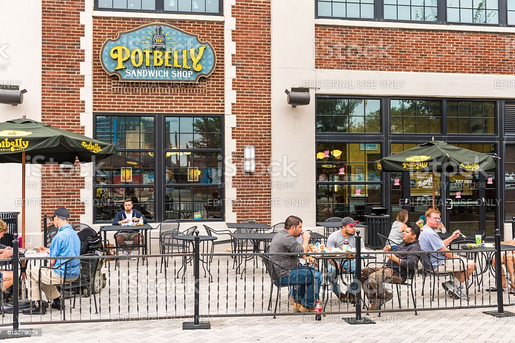 Outside seating area of Potbelly fast food restaurant stock photo