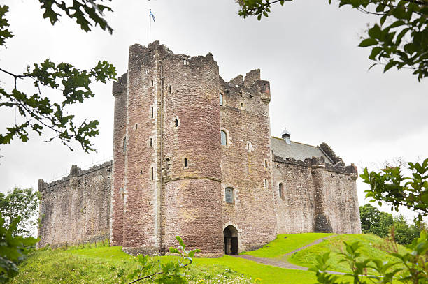 Outside shot of the Doune Castle The 14th century Doune Castle near Stirling, Scotland, seen through trees. theasis stock pictures, royalty-free photos & images