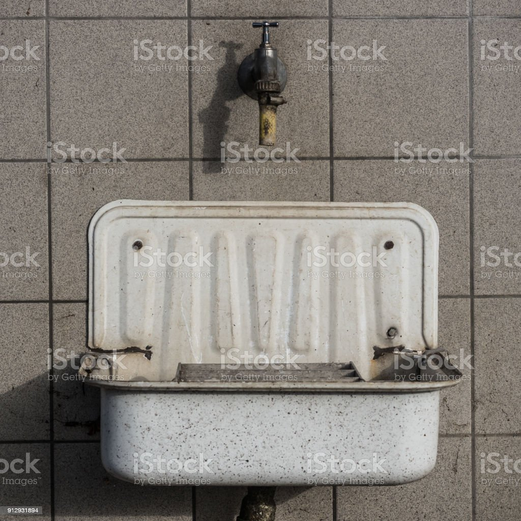 Outside sink on a cemetary stock photo