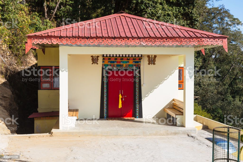 Outside small Temple room with pink hip roof in Guru Rinpoche Temple at Namchi. Sikkim, India. stock photo