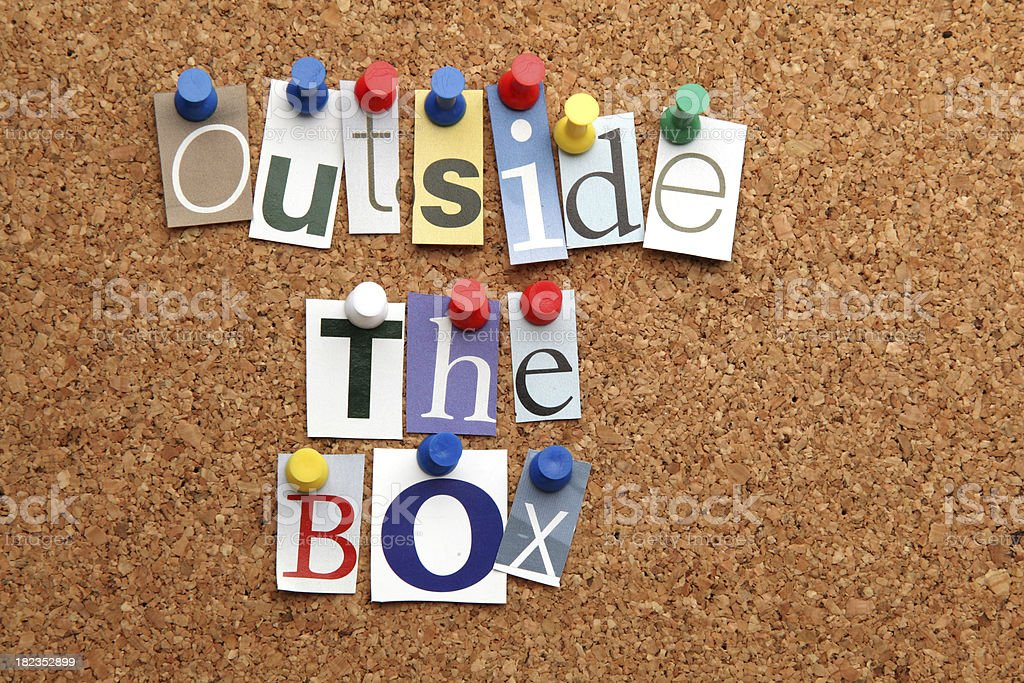 Outside the box pinned on noticeboard royalty-free stock photo