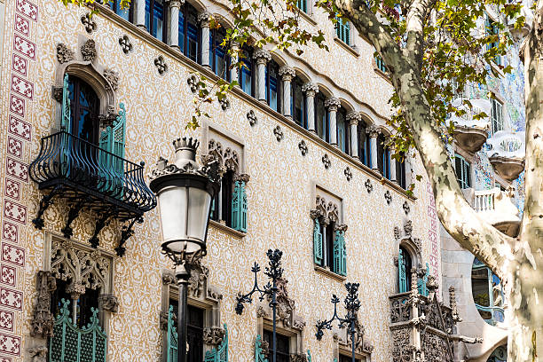Outside the Casa Batlló in Barcelona Casa Batlló in Barcelona is a ornate building restored by Antoni Gaudí and Josep Maria Jujol, built in 1877 and remodelled in the years 1904–1906. The local name for the building is Casa dels ossos (House of Bones), as it has a visceral, skeletal organic quality. passeig de gracia stock pictures, royalty-free photos & images