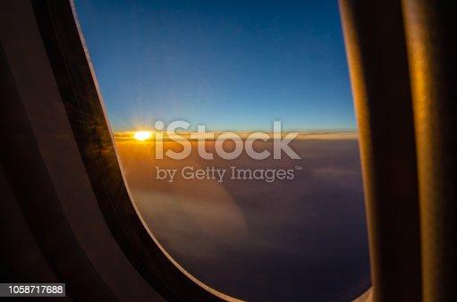 621114928istockphoto Outside the window's airplan sunset seen. 1058717688