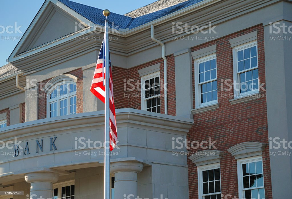 Outside view of a bank with American flag royalty-free stock photo