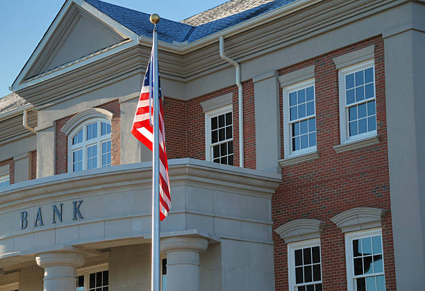 Outside view of a bank with American flag stock photo