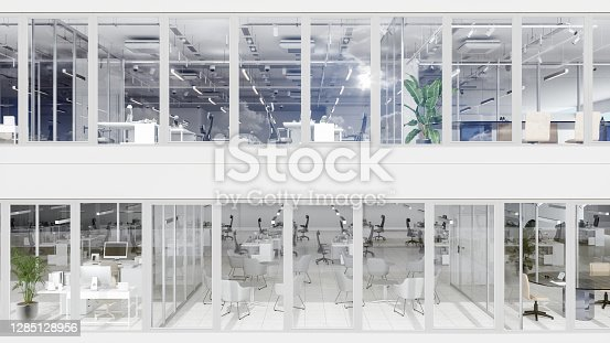 istock Outside View Of Open Office With Tables, Chairs ,Waiting Room And Meeting Room 1285128956