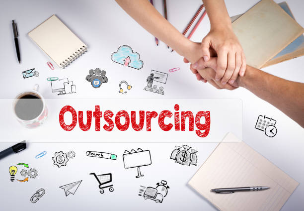 Outsourcing concept Outsourcing concept. The meeting at the white office table. outsourcing stock pictures, royalty-free photos & images