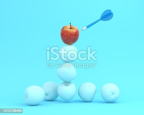 istock Outstanding blue dart in apple on blue pastel background. minimal idea food and fruit concept. An idea creative to produce work within an advertising marketing communications or artwork design. 1010738490