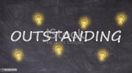 Outstanding written on blackboard with light bulbs