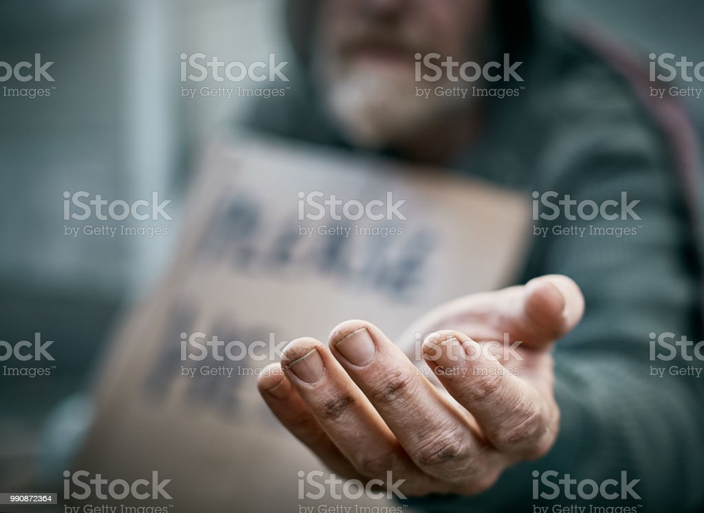Outstretched hand of pathetic beggar stock photo