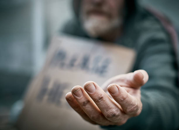 outstretched hand of pathetic beggar - homelessness stock photos and pictures