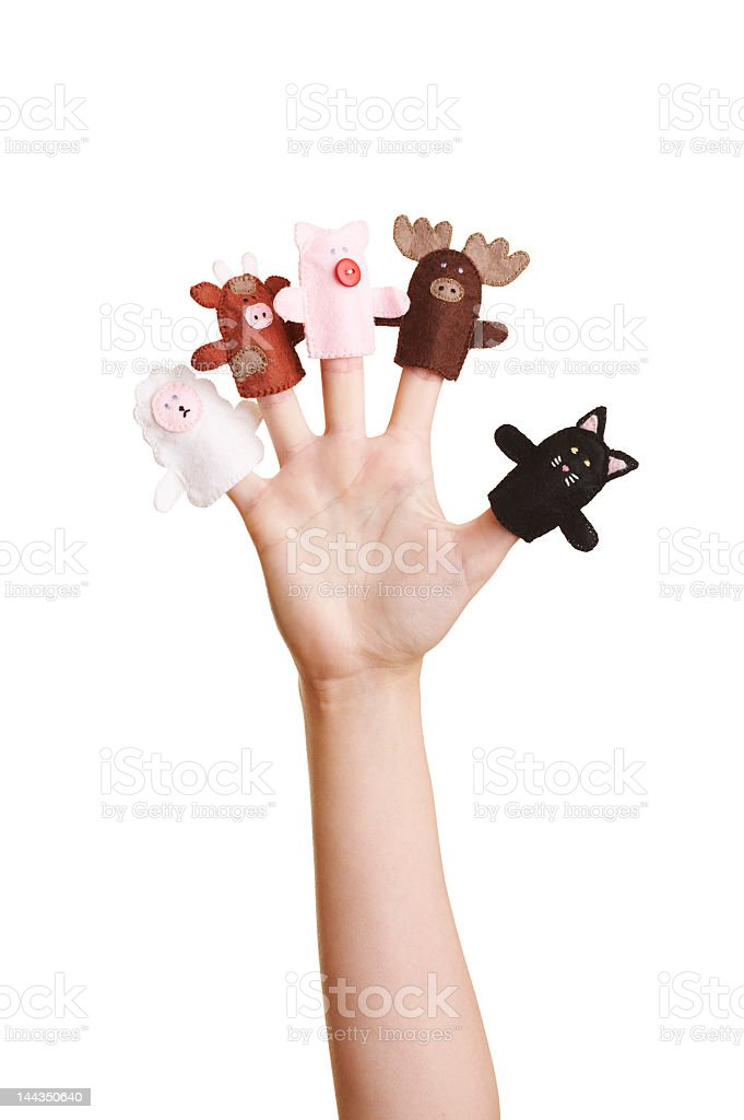 Outstretched hand with finger puppets on each finger royalty-free stock photo