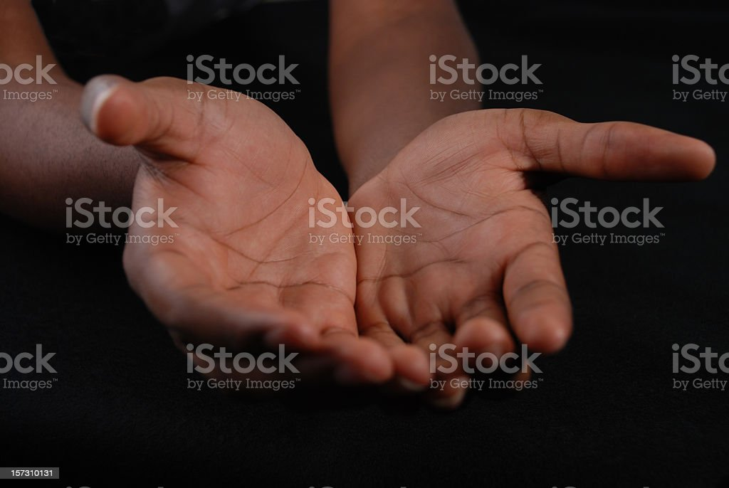 Outstretched hands of a Young Black Man stock photo