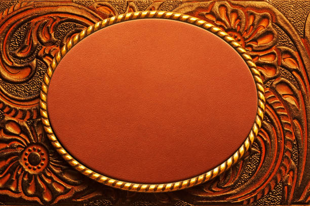Oval Belt Buckle On Tooled Leather Surface stock photo