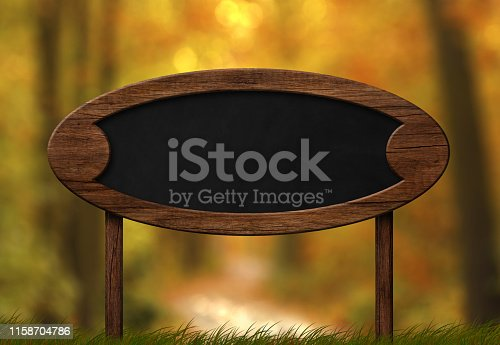istock Oval blackboard sign autumn forest background 1158704786