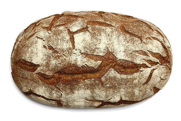 Oval brown bread loaf with distinctive texture stock photo