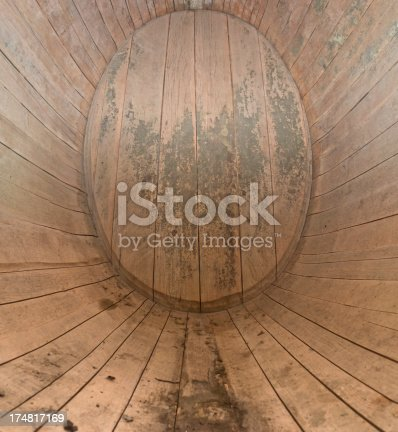 Interior view of a used wine barrel oval. Oak wine barrel with a capacity of 4700 liters and residues from Weinstein.