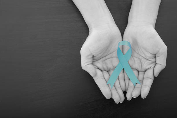 ovarian cancer green ribbon - ovarian cancer ribbon stock pictures, royalty-free photos & images