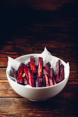 Oven baked beet fries in white bowl