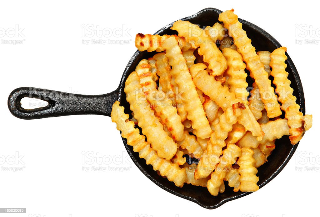 Oven Baked Crinkle Fries in Cast Iron Skillet stock photo