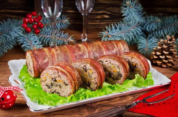Oven Baked meatloaf with bacon, mushrooms, carrots, onions and mashed potatoes stock photo
