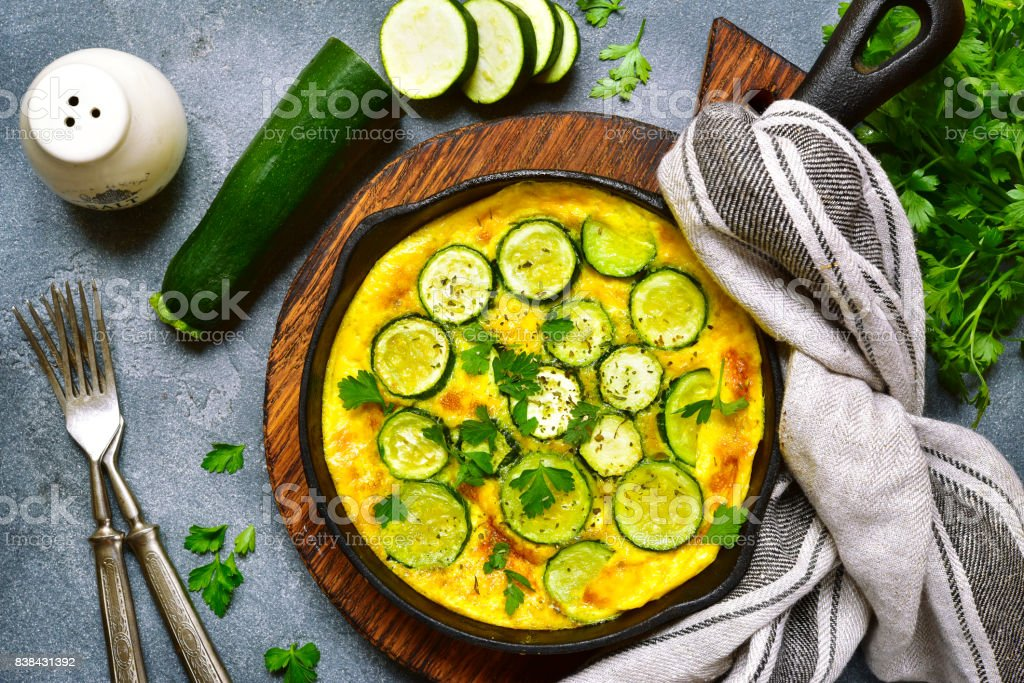 Oven baked omelette with zucchini in a cast iron pan stock photo