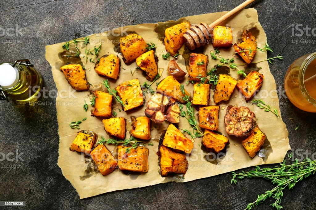 Oven baked pumpkin slices stock photo