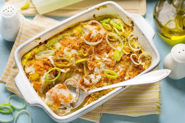 oven dish gratin with cod fish, carrots and leeks - cod imagens e fotografias de stock