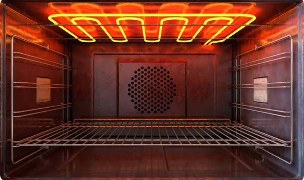 oven new outside view door open An upclose view through the front of the inside of an empty hot operational household oven with a glowing element and metal rack - 3D render oven stock pictures, royalty-free photos & images