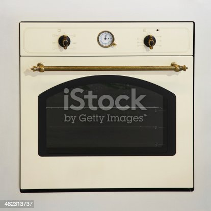 Retro style beige oven with brass details